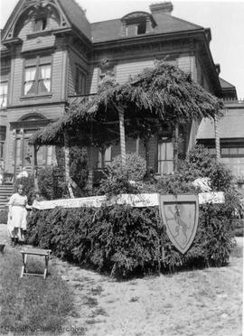 "818 Hillside Avenue, ""Allandale"". James A. Grahame residence, with parade float outside"
