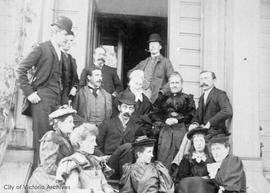 Group of boarders on the steps of Roccabella boarding house, Quadra Street