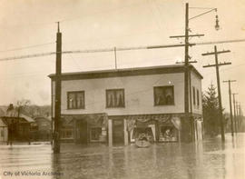 Flooded stores at the N.W. corner of Belmont Road and Haultain Street during a January flood