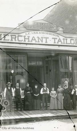 Staff outside Leask and Morrison, Merchant Tailors, 555 Government Street