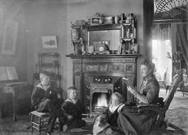 Elworthy children and Mrs. Elworthy in their living room