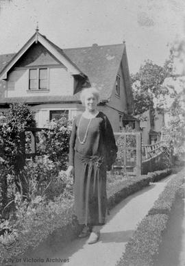 Edith M. Hawkes in front of 1110 Pembroke Street