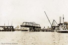 Esquimalt & Nanaimo Railway (E&N) swing bridge at the time of the Johnson Street Bridge c...