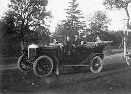 The Cusack family Daimler. Thomas R. Cusack in left front seat, Thomas Plimley Sr. in back seat, ...