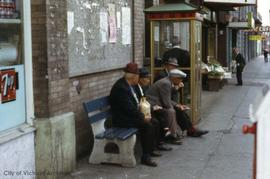 Men sitting on Fisgard Street bench