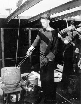 Shipbuilder using a rivet heater