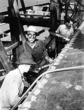 Riveters at work in a shipyard