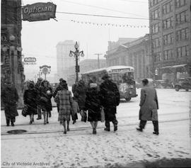 Snow storm.  Douglas Street looking north. FW Francis Jeweller clock in background