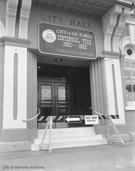 Entrance to City Hall with Centennial year sign over the door
