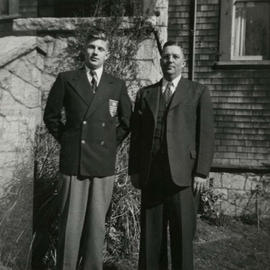 Ainslie James Helmcken with his son Jim, outside their house at 1025 Moss Street