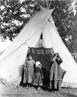 First Nations family outside tent, Fort Vermillion