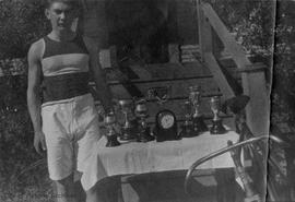 Charles Staples with cycling trophies