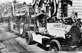 Mr. Brindle driving a Victoria Fire Department truck in the 1919 Empire Day parade