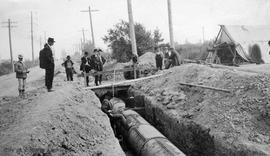 Sooke water supply. Testing pipe, Burnside Road