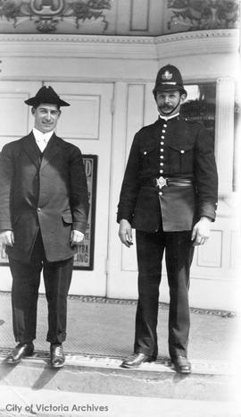 Victoria Police Constable John Fry and friend at the entrance to the Empress Grand Theatre