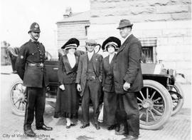Group with policeman on Wharf Street and Humboldt Street