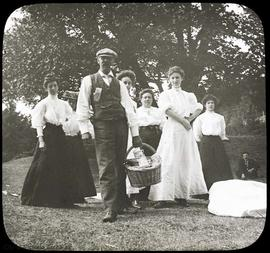 Family picnic. Christopher Hollyer holding basket