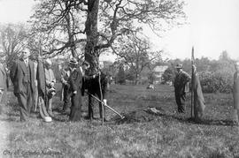Mayor Herbert Anscomb planting tree in Mayor's Grove, Beacon Hill Park