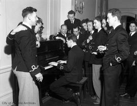 Officers gathered around a piano at Prince Robert House