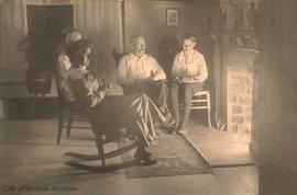 William A. Blake and family beside the fireplace at 849 Princess Avenue