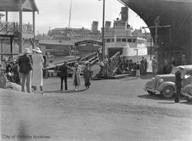 "Disembarking from the ""Olympic"" ferry which took cars and passengers from Victoria to Port Angeles, Washington State"