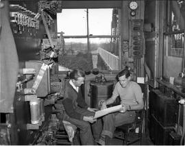 Johnson Street Bridge showing the interior of the control room. John Campbell and John Kirkendale