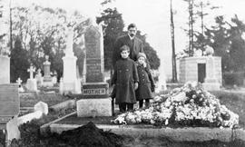 Evans family at grave in Ross Bay Cemetery