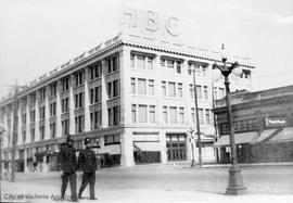 Policemen on Douglas Street in front of Hudson's Bay department store