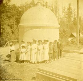 Henderson children in front of the expansion bell.  Part of the Water Works at Goldstream