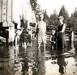 Family group bathing (possibly members of the McConnell family)