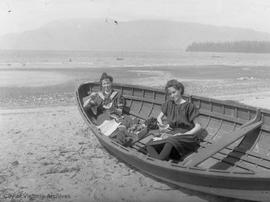 Two women having a picnic in a boat (in Vancouver?)