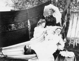 Three unidentified women by hammock