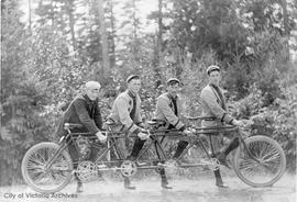 Four cyclists with a four-seater bicycle. Possibly Robillard family