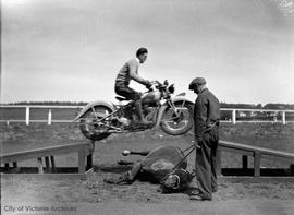 Bob Shanks, stunt rider on motorcycle at Willows Fairgrounds