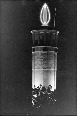 Rockland water tower lit up at night with neon candle