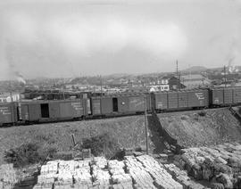 Train cars near Sidney Roofing and Paper.  Harbour Road area in background