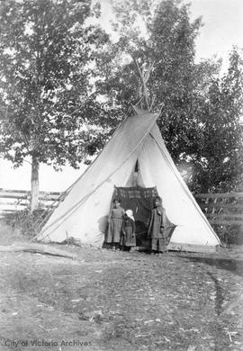 Children of Mrs. Victoria Peachimee outside their home at Fort Vermillion on the Peace