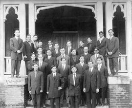 Group outside unidentified building, possibly missionaries