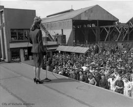Actress Barbara Stanwick addressing shipyard workers at the VMD in support of the fourth Victory ...