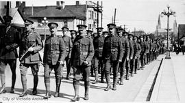 Troops marching along Quadra Street