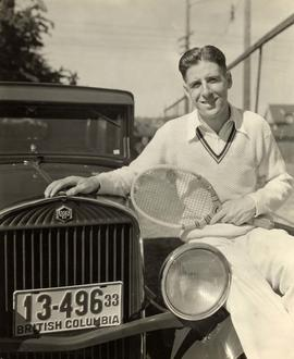 "Ross V. ""Bud"" Hocking as No. 1 tennis player poses next to car"