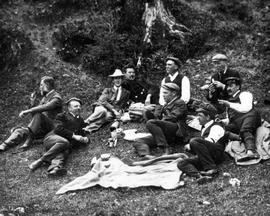 Group of unidentified men having a picnic