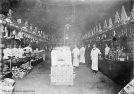 Dixi Ross & Co. Grocery Store, interior.  James Slater centre background