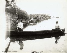 Two unidentified women in canoe