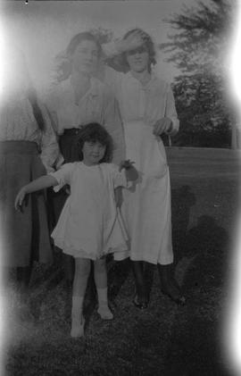 Anna, Ruth, and Dolly McBride with their little sister Sheila. Taken at their house