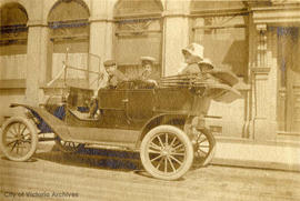 Ainslie, John, Mrs. Helmcken and Edith in the family's Model T Ford outside 1103 Langley Street