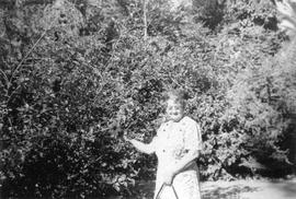 Mary Foster beside tree in California