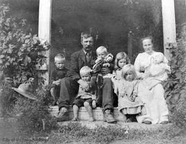 Laurence family on the front steps of their home.  They had the most northern wheat field in Nort...