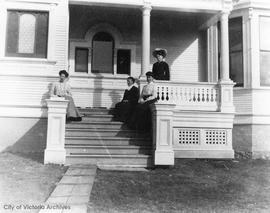 Rebecca Muirhead and her daughters on the steps of 223 Robert Street