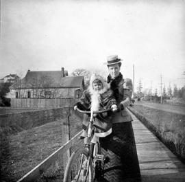 Mary Eleanor Oliver (nee Ward) and daughter Catherine on a bicycle